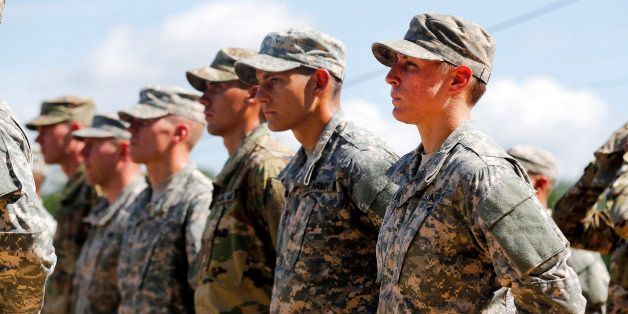 U.S. Army First Lt. Shaye Haver, right, stands in formation during an Army Ranger school graduation ceremony Friday, Aug. 21,