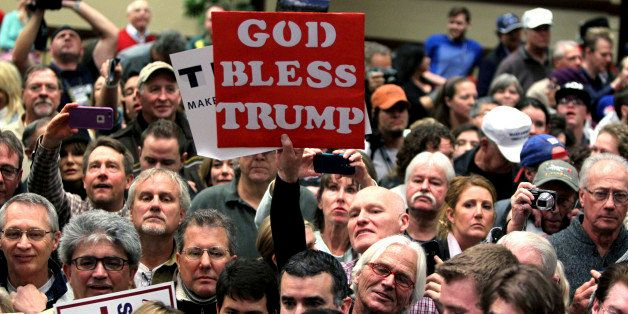 People listen to Republican presidential candidate Donald Trump at a rally Sunday, Jan. 10, 2016, in Reno, Nev. (AP Photo/Lan