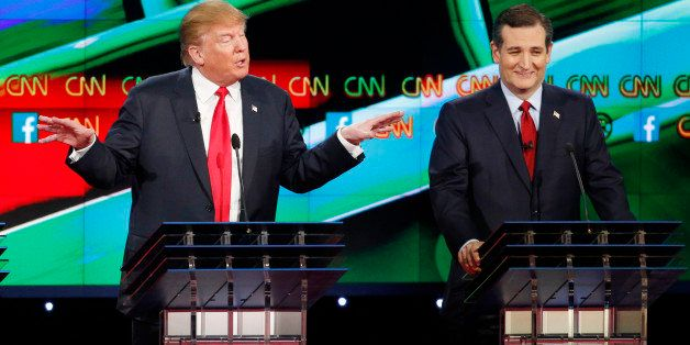 Donald Trump, left, speaks as Ted Cruz looks on during the CNN Republican presidential debate at the Venetian Hotel & Cas
