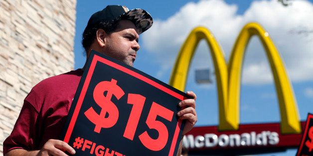 Supporters of a $15 minimum wage for fast food workers rally in front of a McDonald's on Wednesday, July 22, 2015, in Albany,