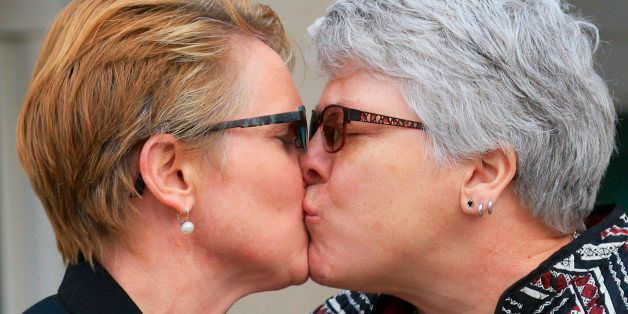 FILE- In this Feb. 19, 2015, file photo, Marj Plumb, right, and Tracy Weitz, one of seven same-sex couples who had sued to bl