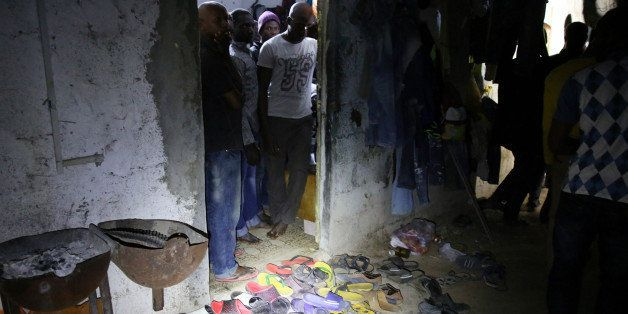 African migrants are crowded into a room during a raid by immigration police on the outskirts of Tripoli, Libya, early Tuesda
