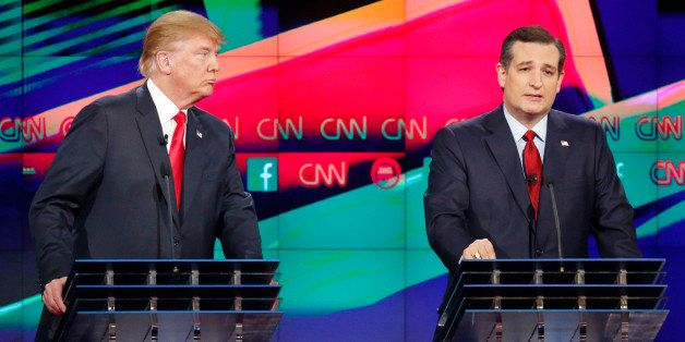Ted Cruz, right, speaks as Donald Trump looks on during the CNN Republican presidential debate at the Venetian Hotel & Ca