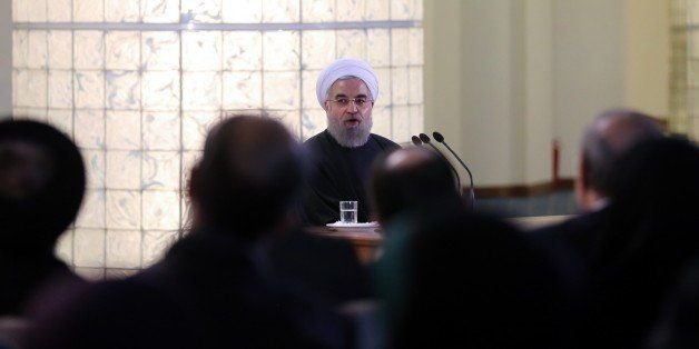 TEHRAN, IRAN - JANUARY 17: Iranian President Hassan Rouhani (C) gives a speech during a press conference in Tehran, Iran on J
