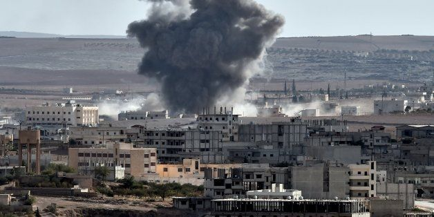 Smoke rises from an airstrike in the Syrian town of Ain al-Arab, known as Kobane by the Kurds, as seen from the Turkish-Syria