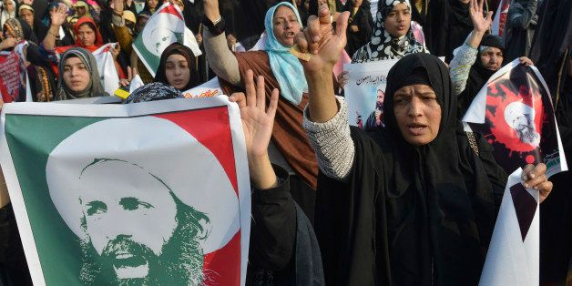 Pakistani Shiite Muslim women shout slogans during a protest in Lahore on January 3, 2016, against the execution of prominent