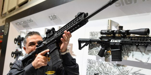 LAS VEGAS, NV - JANUARY 19:  Glen Kukula checks out a Patrol SIG716 rifle by Sig Sauer at the 2016 National Shooting Sports F
