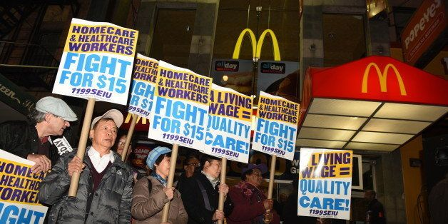 BROOKLYN, NEW YORK CITY, UNITED STATES - 2015/11/10: Home health activist with signs array in front of downtown Brooklyn McDo