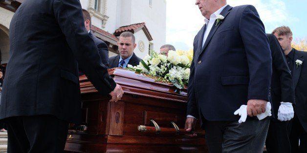 Pallbearers carry the casket of 58-year-old San Bernardino shooting victim Damian Meins on December 11, 2015 in San Bernardin