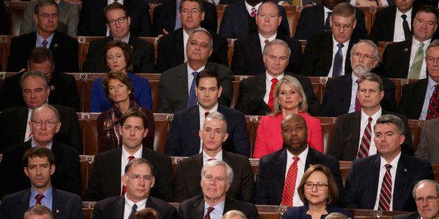 WASHINGTON, DC - JANUARY 12:  Members of congress including Republican presidential candidate Sen. Marco Rubio (R-FL) (C) lis