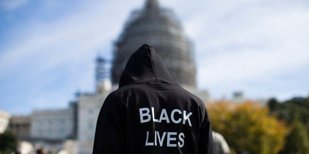 "Neal Blair, of Augusta, Ga., wears a hoodie which reads, ""Black Lives Matter"" as stands on the lawn of the Capitol building d"