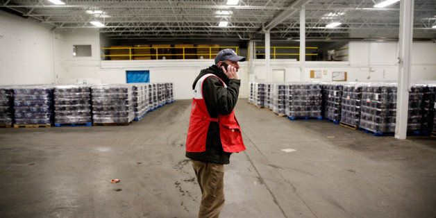 FLINT, MI - JANUARY 21:  American Red Cross volunteer John Lohrstorfer in the warehouse full of water bottles for Flint resid