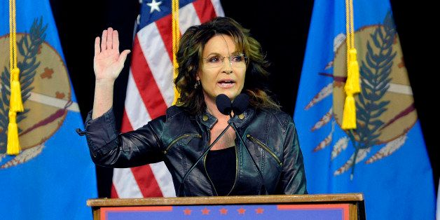 Former Republican vice presidential candidate Sarah Palin speaks to a crowd as she introduces Republican presidential candida