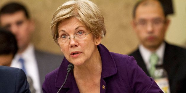 Sen. Elizabeth Warren, D-Mass., speaks to a conference as House and Senate negotiators try to resolve competing versions of a