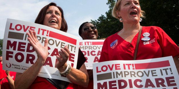Nurses, from left, Katie Murphy of Boston, Kimberly Wallace of Buffalo, N.Y., and Nora Watts of Westborough, Mass., participa