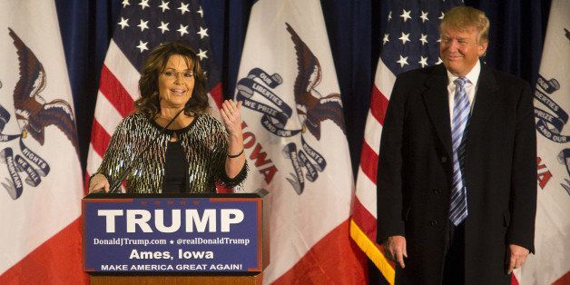 Sarah Palin, former governor of Alaska, left, speaks as Donald Trump, president and chief executive of Trump Organization Inc