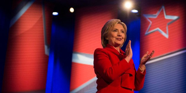 Democratic presidential candidate Hillary Clinton applauds during the CNN Town Hall at Drake University in Des Moines , Iowa,