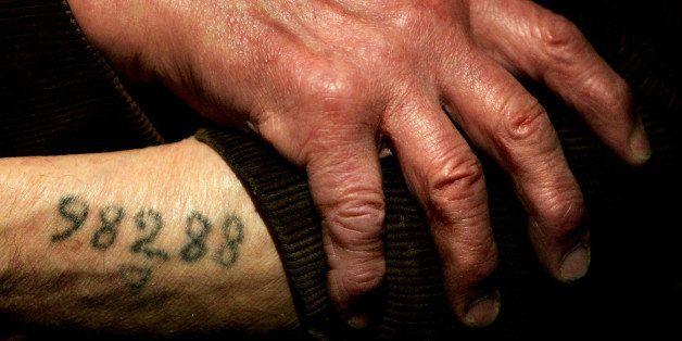 LONDON - DECEMBER 9:  Auschwitz survivor Mr. Leon Greenman, prison number 98288, displays his number tattoo on December 9, 20
