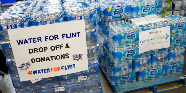 WINDSOR, ON - JANUARY 21: Fans bring in donations of bottled water prior to the game between the Flint Firebirds and the Wind