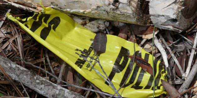 NBC NEWS -- Pictured: Small pieces of police tape left behind at the wooded site in Ft Myers, Florida, where eight sets of hu