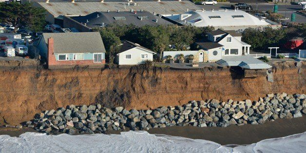 Houses are seen hanging over a cliff in Pacifica, California on January 27, 2016.