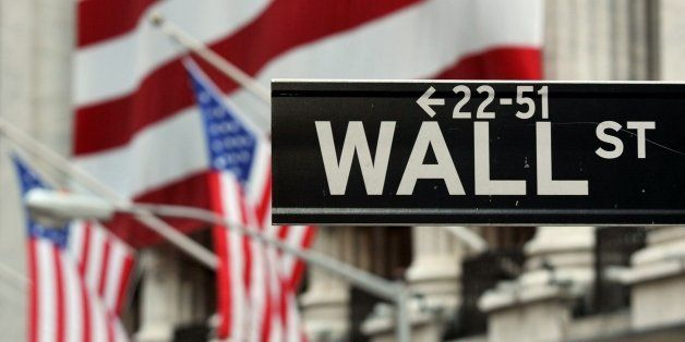 The Wall Street sign near the front of the New York Stock Exchange August 5, 2011.  AFP PHOTO/Stan HONDA        (Photo credit