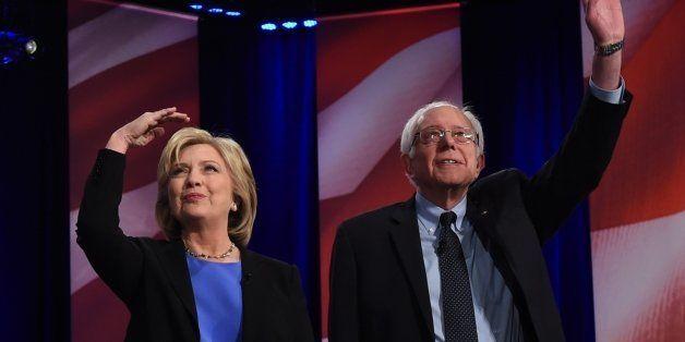 Democratic presidential candidate, former Secretary of State Hillary Clinton (L) and Vermont Senator Bernie Sanders (R) arriv