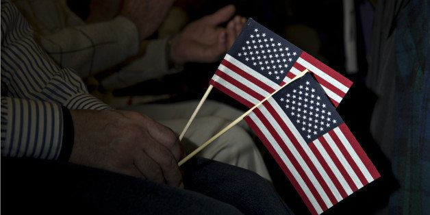 An attendee holds American flags as Senator Bernie Sanders, an independent from Vermont and 2016 Democratic presidential cand