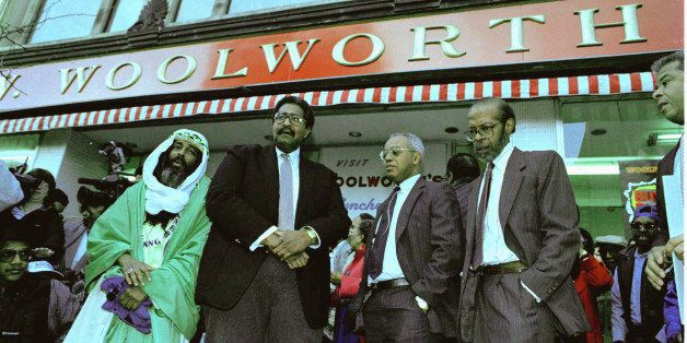 Four men who 34 years ago were denied service at a Woolworth store in Greensboro, N.C., pause in front of the store, Feb. 1,