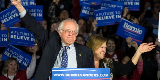 Democratic presidential candidate, Sen. Bernie Sanders, I-Vt,  and his wave Jane acknowledge the crowd as he arrives for his