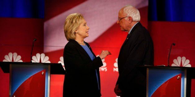 Democratic presidential candidate, Hillary Clinton and Democratic presidential candidate, Sen. Bernie Sanders, I-Vt. speak du