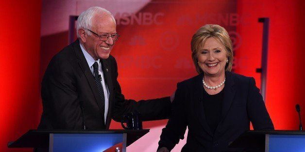 US Democratic presidential candidates Hillary Clinton (R) and Bernie Sanders smile after participating in the MSNBC Democrati