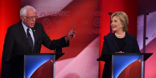 US Democratic presidential candidates Hillary Clinton (R) and Bernie Sanders participate in the MSNBC Democratic Candidates D