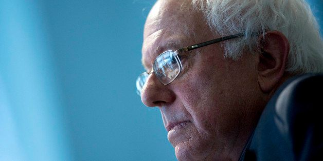 Senator Bernard 'Bernie' Sanders, an independent from Vermont and possible presidential candidate, listens to a question duri
