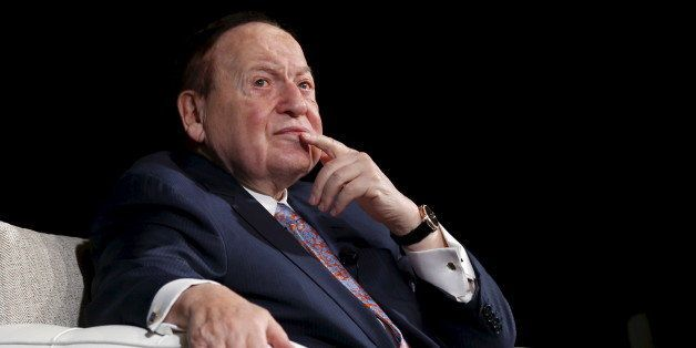 Gambling giant Las Vegas Sands Corp's Chief Executive Sheldon Adelson reacts during a news conference in Macau, China Decembe