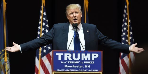 US Republican presidential hopeful Donald Trump speaks to the crowd during a rally February 8, 2016 in Manchester, NH. US pr