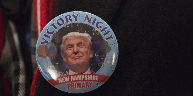 An attendee wears a victory campaign button for Donald Trump, president and chief executive of Trump Organization Inc. and 20