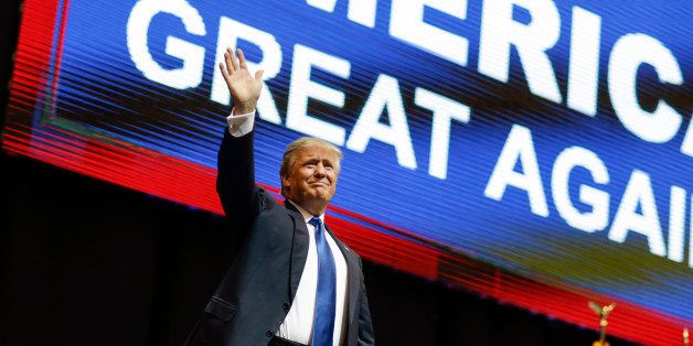 Republican presidential candidate, businessman Donald Trump waves has he arrives for a campaign rally Monday, Feb. 8, 2016, i