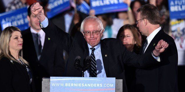 US Democratic presidential candidate Bernie Sanders gestures on stage during a primary night rally in Concord, New Hampshire,