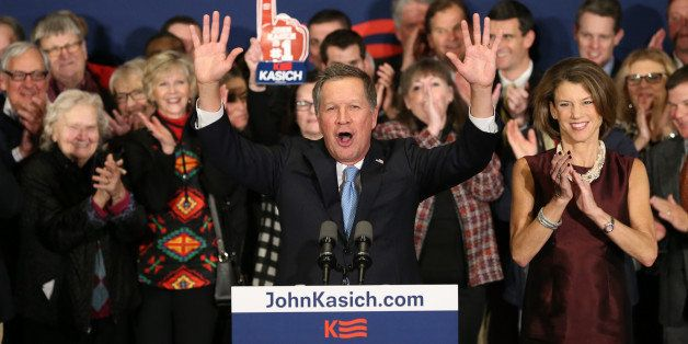 CONCORD, NH - FEBRUARY 09:  Republican presidential candidate Ohio Governor John Kasich speaks at a campaign gathering with s