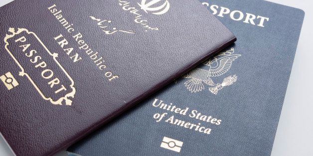 U.S. passport with an Iranian passport on a white background