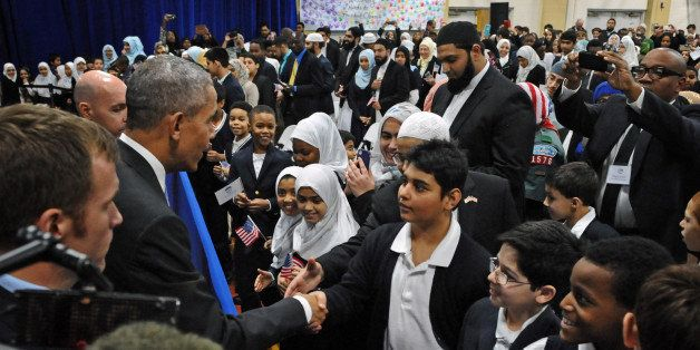 President Barack Obama shakes hand with students of the Al-Rahmah School during his visit to the Islamic Society of Baltimore