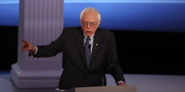 US Democratic presidential candidate Bernie Sanders participates in the PBS NewsHour Presidential Primary Debate with Hillary