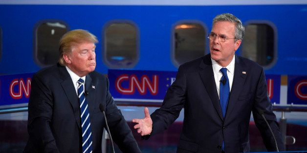 Republican presidential candidate Donald Trump, left, listens as former Florida Gov. Jeb Bush speaks during the CNN Republica
