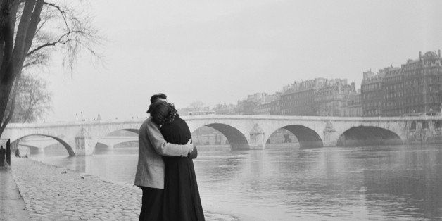 a courting couple on the bank of the Seine, Paris, 1954. (Photo by Fred Van Schagen/BIPs/Hulton Archive/Getty Images)