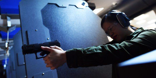 A woman fires a handgun at the RTSP shooting range in Randolph, New Jersey on December 9, 2015. US President Barack Obama cal