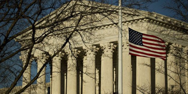 The American flag flies at half-staff in front of the U.S. Supreme Court building in Washington, D.C., U.S., on Tuesday, Feb.