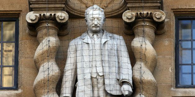 OXFORD, ENGLAND - FEBRUARY 02:  A statue of Cecil Rhodes is displayed on the front of on Oriel College on February 2, 2016 in