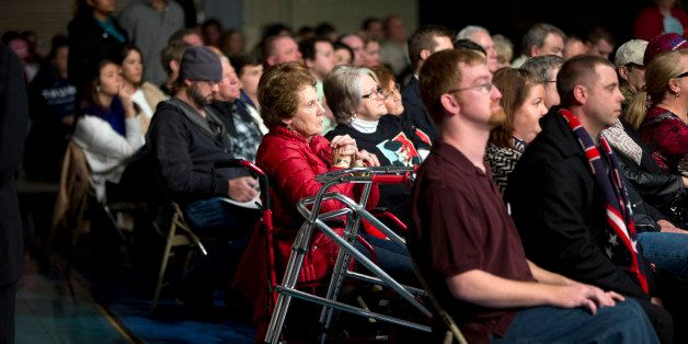 Members of the audience listen as Republican presidential candidate Donald Trump speaks at a rally at Sumter Country Civic Ce