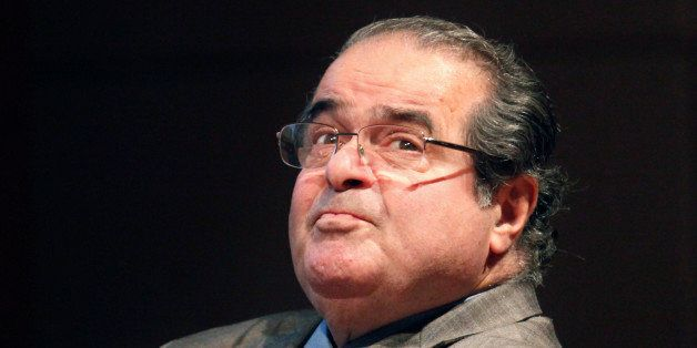 FILE - In this Oct. 18, 2011 file photo, U.S. Supreme Court justice Antonin Scalia looks into the balcony before addressing t